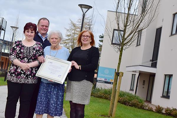 Limewood staff with gold certificate for dementia award
