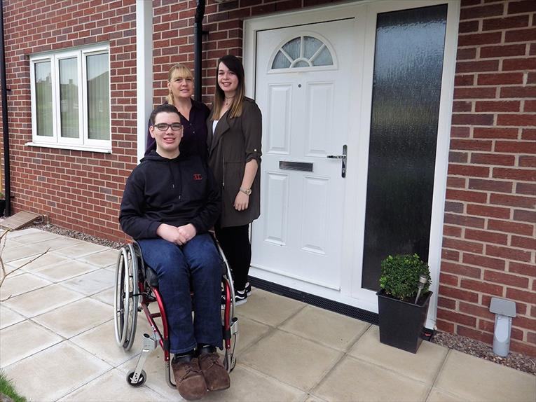 Lewis with family outside home in Newport